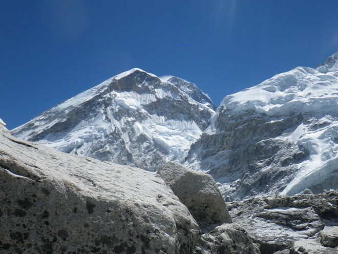 to the left: west shoulder of Everest.  To the right: part of Nuptse ridge.  In the center, hiding from the view: the summit of Everest with the tell-tale jet-stream of wind and ice